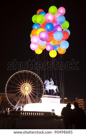 Balloons and Ferris wheel festival of lights Lyon