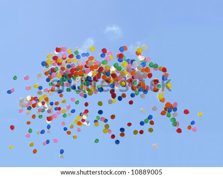 Balloons flying in the blue sky