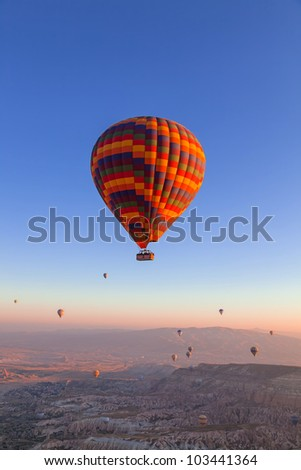 Balloons in the sky over Cappadocia at sunrise - stock photo