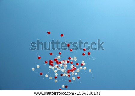 balloons in the sky. red white color of polish flag. Balloons Polish flag on 11 november concept.  Zdjęcia stock ©
