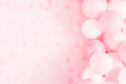 Balloons on pastel pink background. Frame made of white and pink balloons. Birthday, holiday concept. Flat lay, top view, copy space