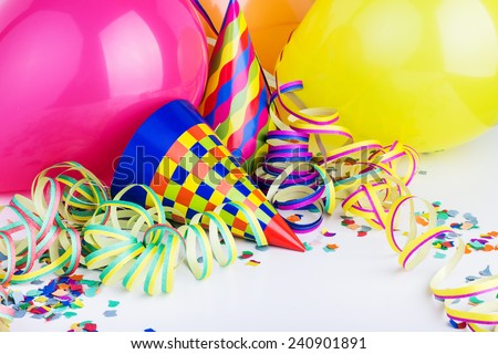 Balloons, streamers, confetti and party hats/party/carnival