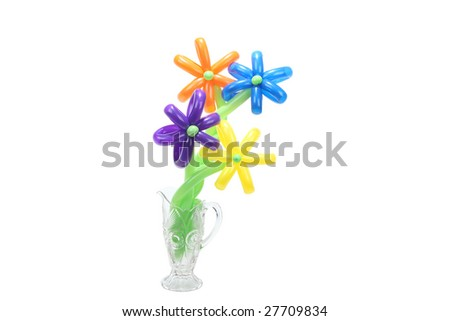 balloons twisted into a blossoming flower bouquet in vase isolated on white