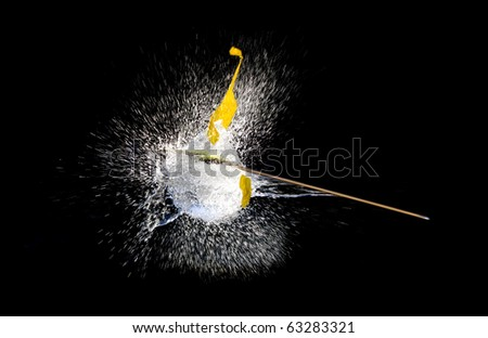 Balloons with water bursting punctured by arrow.High speed photography.