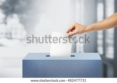 Ballot box with person vote on blank voting slip voting concept.