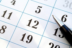 ballpoint pen and a calendar of close-up