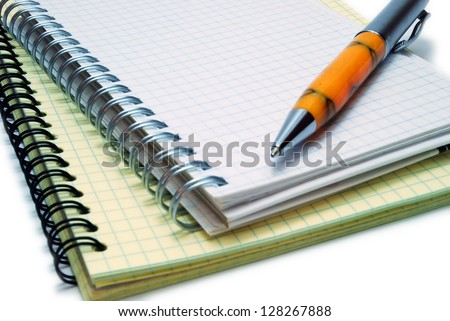 Ballpoint Pen on Notebooks Isolated on White