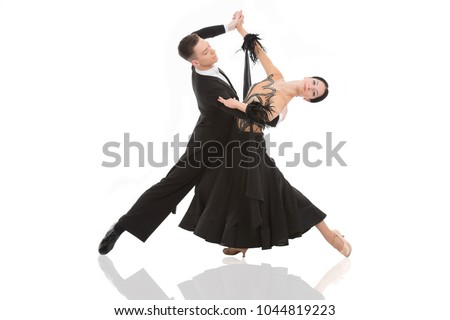 ballroom dance couple in a dance pose isolated on white background. ballroom sensual proffessional dancers dancing walz, tango, slowfox and quickstep just dance
