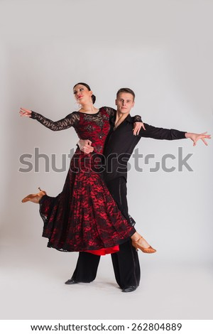 Ballroom dancing. Man and woman posing in dance pose on light. Man and woman dancing ballroom dances. Beautiful man and woman doing the dance steps. Dance poses.