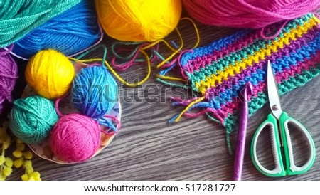 Balls of multicolored yarn for knitting and crochet with craft accessories #517281727