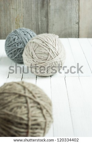 balls of wool on white wooden