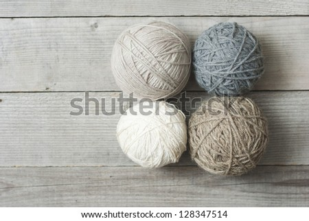 balls of wool on wooden table background, directly above