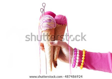 free photos hand holding a red spool of thread on a white background