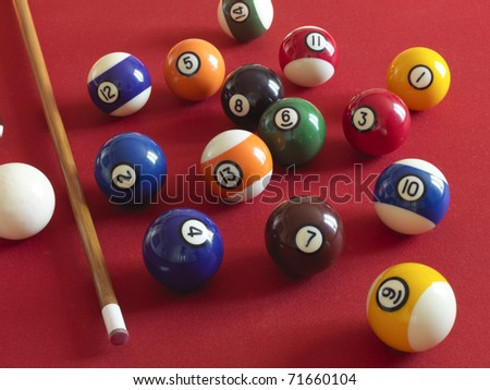 balls on the billiard with red carpet