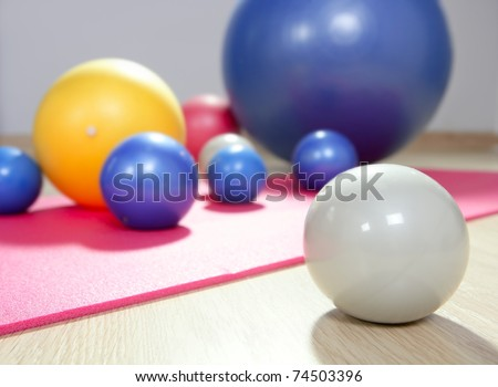 balls stability and toning pilates sport gym on red yoga mat