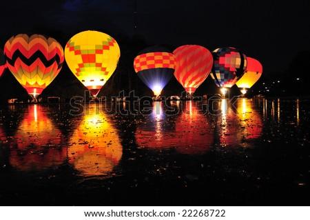 Stock Photo Balluminaria 2008, The world's largest hot air balloon glow reflected in the frozen water of Mirror Lake in Eden Park Cincinnati Ohio USA