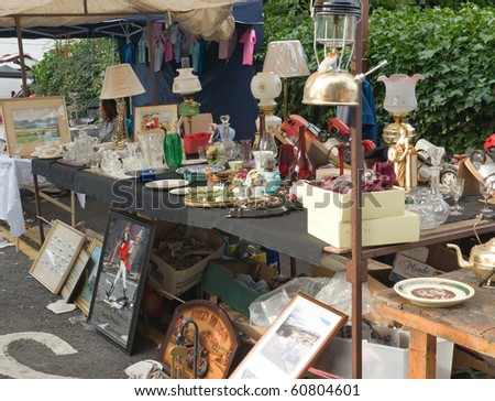 BALLYCASTLE, N. IRELAND - AUGUST 31:Unidentified woman sells antiques at the Ould Lammas Fair on August 31, 2010 in Ballycastle, N. Ireland. This annual market is now over three centuries old.