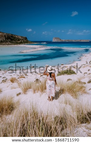 Balos Beach Crete Greece, Balos beach is on of the most beautiful beaches in Greece at the Greek Island, woman in a swimsuit on the beach