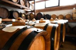 Balsamic vinegar is getting older inside wooden barrels. Modena, Italy 2015