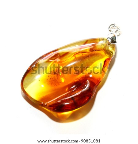 Baltic amber pendant isolated on white