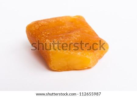 Baltic amber stone on white background