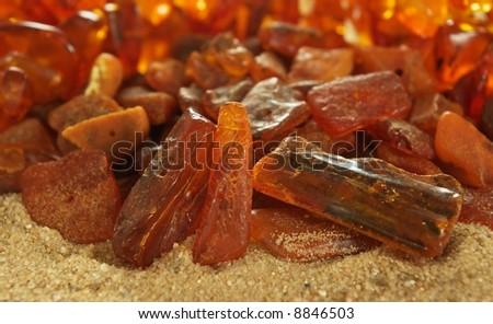 Baltic Sea amber on sandy background