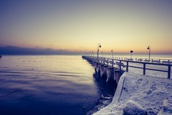 Baltic sea and pier in gdynia orlowo in poland in the winter.
