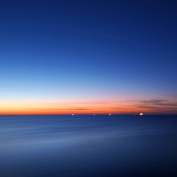 baltic sea bay with ship at the horizon