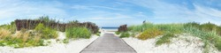 Baltic Sea Beach Dune Path, Ocean View. Sunny Weather with Clouds. Panorama Ostsee