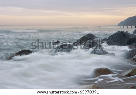 Baltic sea coast photographed with long exposure in pastel colors.