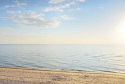 Baltic sea coast (sand dunes) at sunset. Clear blue sky. Soft sunlight, golden hour. Pure nature, environmental conservation, ecology, ecotourism, hiking, vacations, recreation. Panoramic view