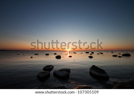 Baltic sea stones at sunset