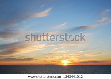 Baltic sea sunset with clouds and blue sky #1343441012