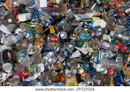 BALTIMORE - CIRCA 2008: Aluminum cans and plastic bottles lie in a heap at an undisclosed recycling facility to be sorted, circa 2008 in Baltimore. The cans and bottles will be compressed and baled.