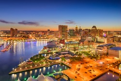 Baltimore, Maryland, USA inner harbor and downtown skyline at twilight.