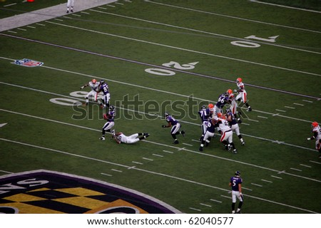 BALTIMORE - SEPTEMBER 21: Ravens running back Willis McGahee tries to break the tackle of Browns linebacker Alex Hall in a game at M&T Bank Stadium September 21, 2008 in Baltimore, MD.