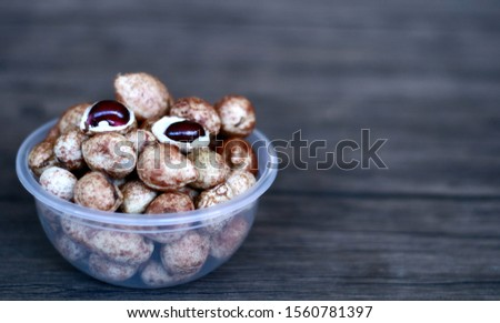Bambara groundnut or Vigna subterranea (Kacang Bogor) on wood background.