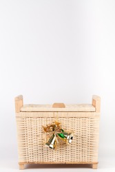 Bamboo basket isolated on white background Decorated with golden bell on top