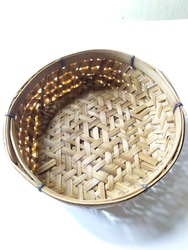 Bamboo basket top view. Handmade basketry weaving