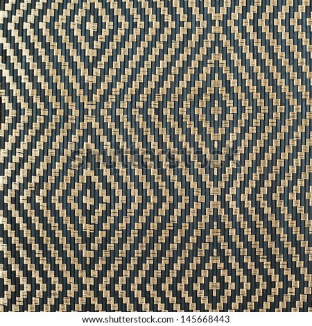 Bamboo black straw mat as abstract texture background composition, top view above