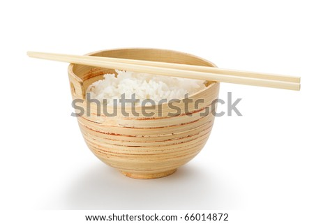 Bamboo bowl with plain rice and chopsticks on white background.