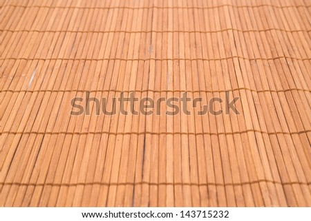 Bamboo brown straw mat as a background composition with a shallow depth of field