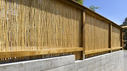 Bamboo fence wall by garden