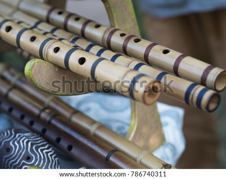 Bamboo flutes shakuhachi. Stand on the stand. Folk Japanese musical instruments. On open air. #786740311