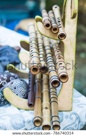 Bamboo flutes shakuhachi. Stand on the stand. Folk Japanese musical instruments. On open air. #786740314