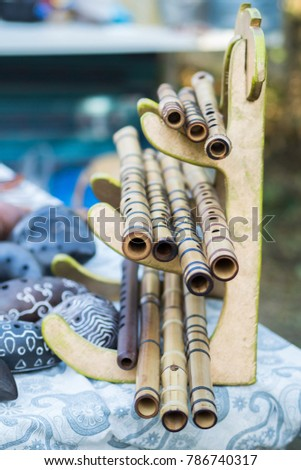 Bamboo flutes shakuhachi. Stand on the stand. Folk Japanese musical instruments. On open air. #786740317