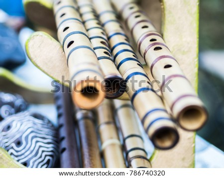 Bamboo flutes shakuhachi. Stand on the stand. Folk Japanese musical instruments. On open air. #786740320