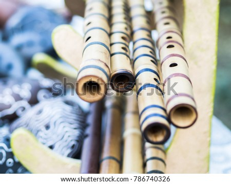 Bamboo flutes shakuhachi. Stand on the stand. Folk Japanese musical instruments. On open air. #786740326