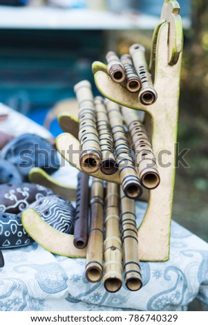 Bamboo flutes shakuhachi. Stand on the stand. Folk Japanese musical instruments. On open air. #786740329