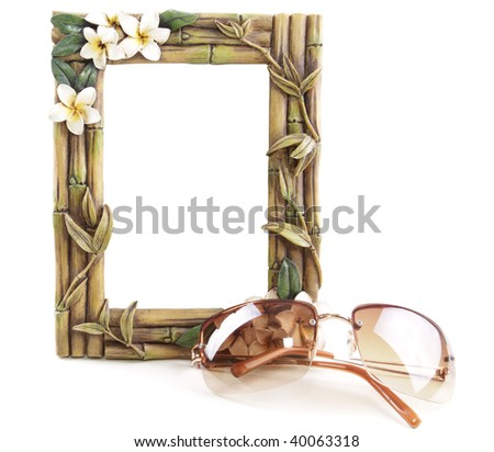 Bamboo frame and sunglasses isolated on white